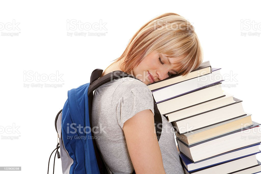 Female holding a stack of books royalty-free stock photo