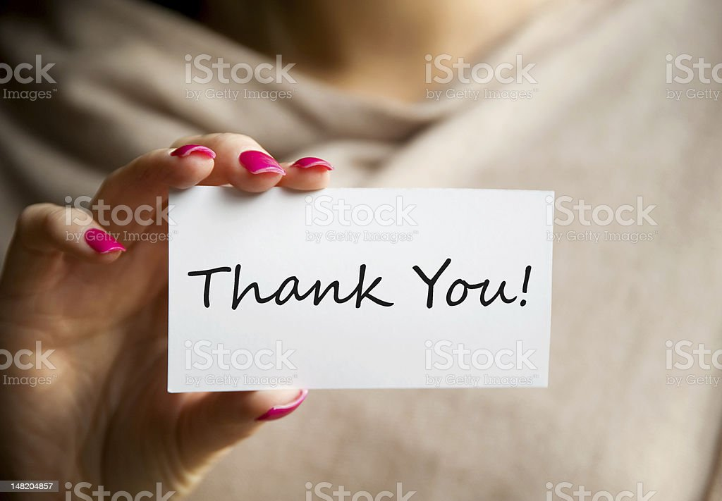 Female holding a white Thank You Card stock photo