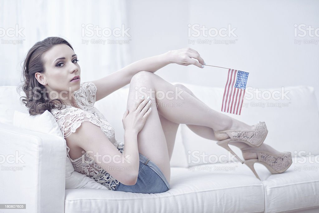 Female Holding An American Flag royalty-free stock photo