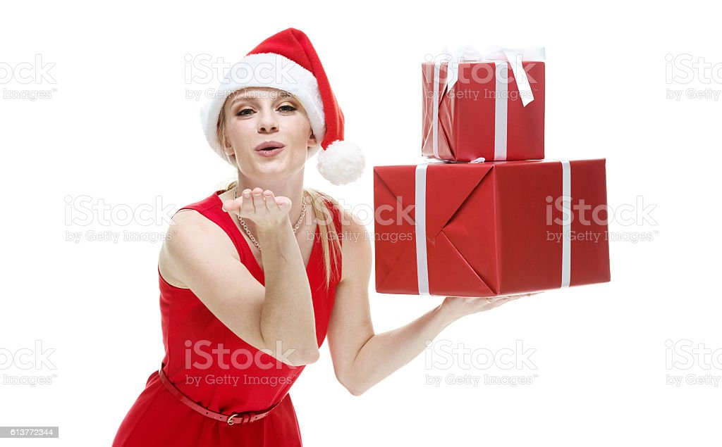 Female holding gift box and blowing a kiss stock photo