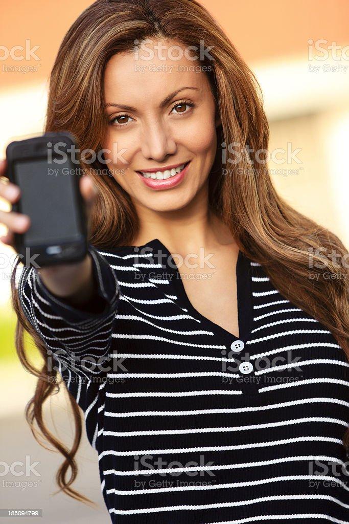 Female holding mobile phone stock photo
