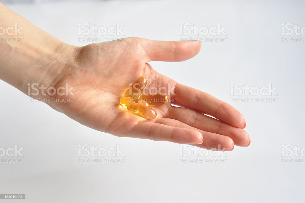 female holding supplements in her palm royalty-free stock photo
