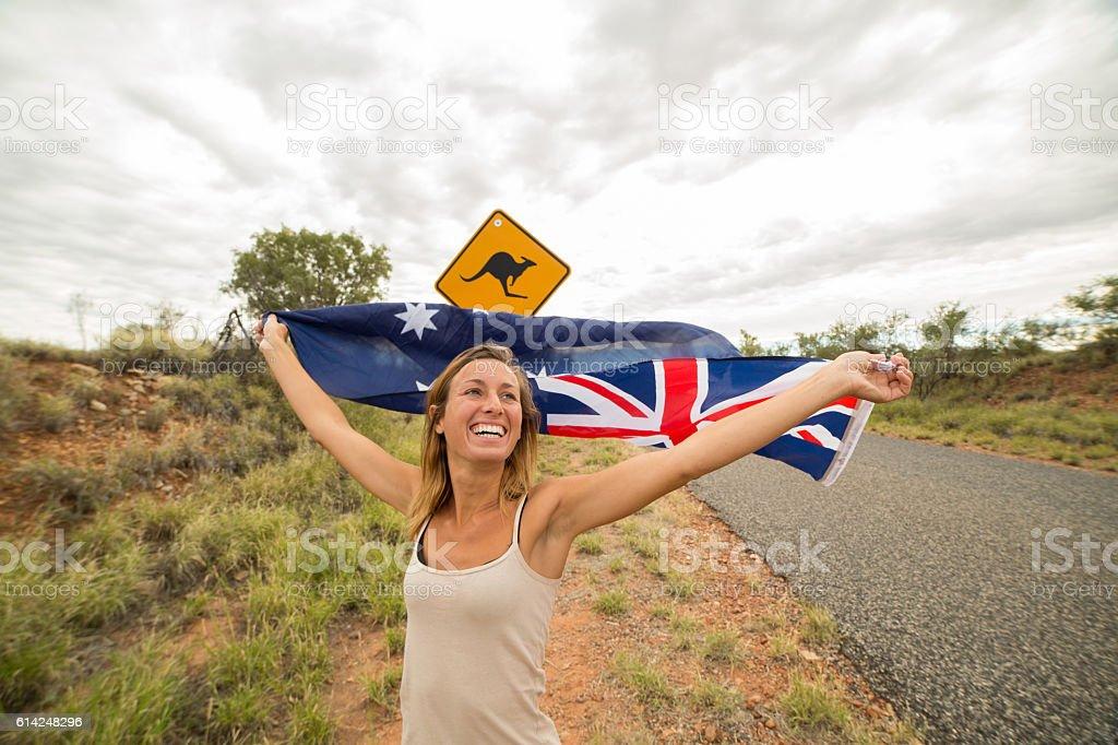 Female holds Australian flag neat Kangaroo sign stock photo