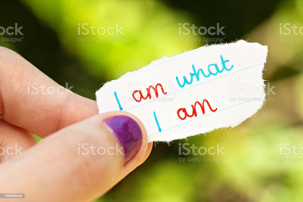 Female holds hand-drawn message: I am what Iam stock photo
