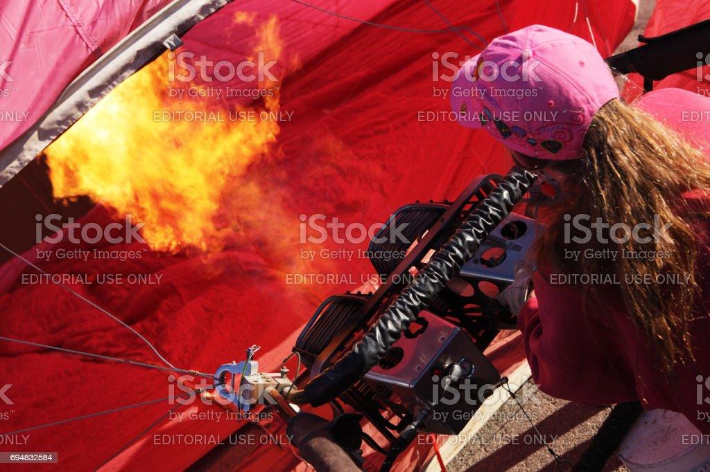 Female Hot Air Balloon Pilot Inflating Envelope stock photo