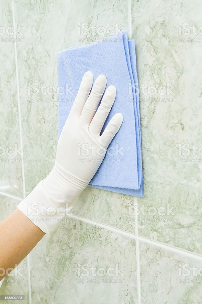 Female household, tile cleaning with gloves royalty-free stock photo