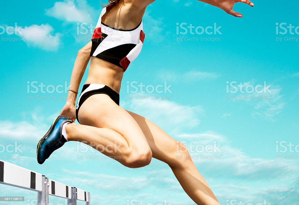 Female hurdle runner stock photo