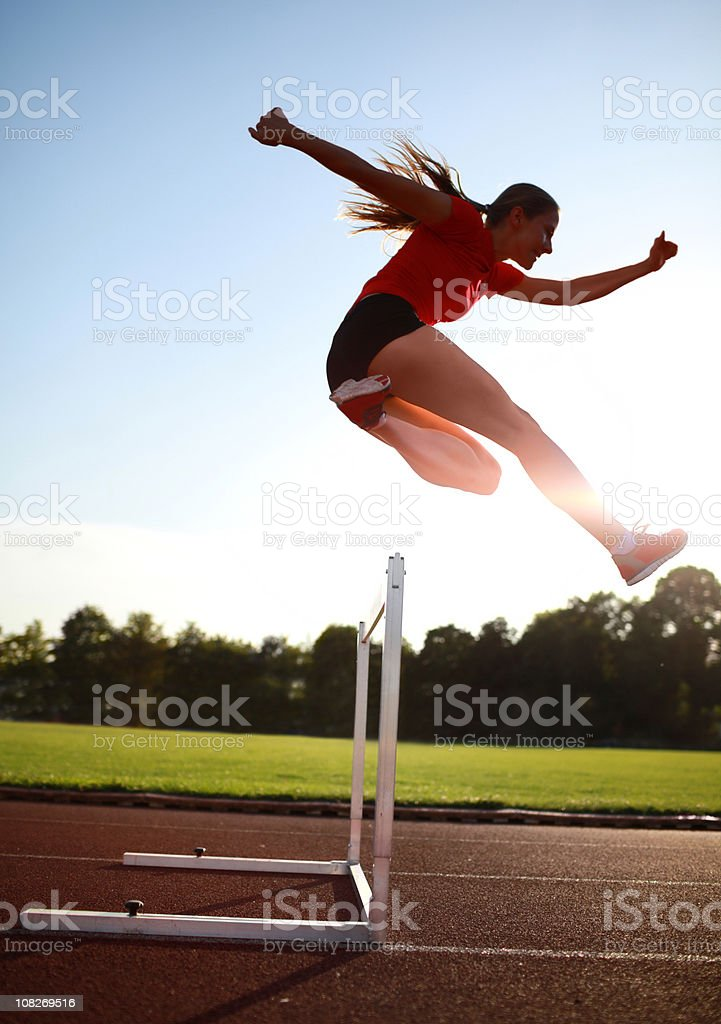 female hurdler stock photo