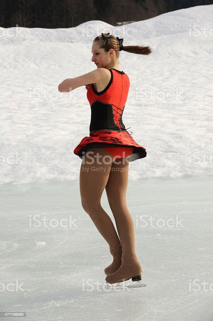Female ice skater spinning stock photo