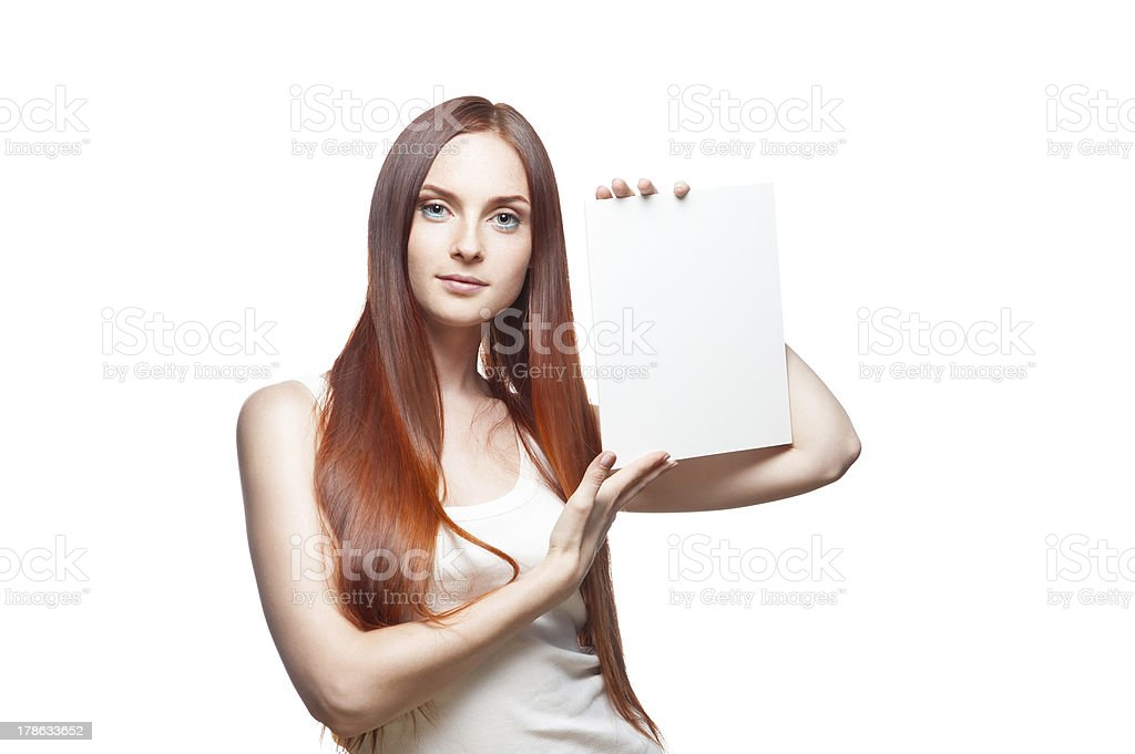 female in casual outfit holding sign royalty-free stock photo