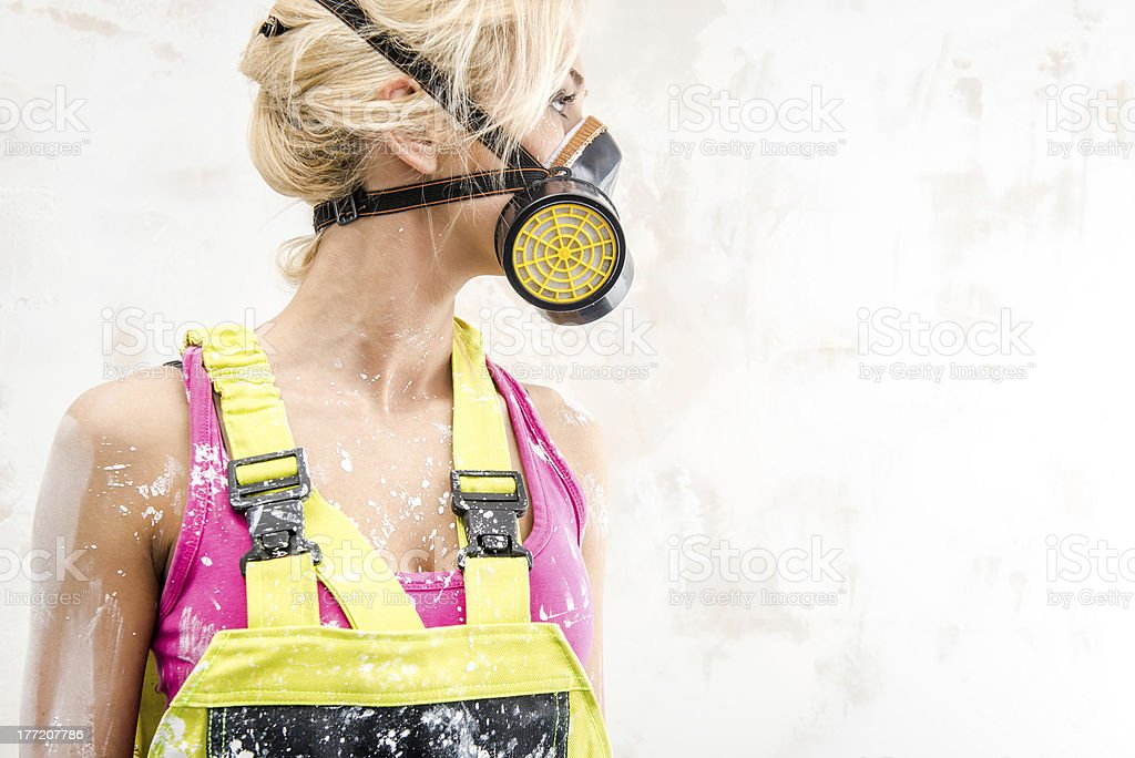 Female in coverall and respirator royalty-free stock photo