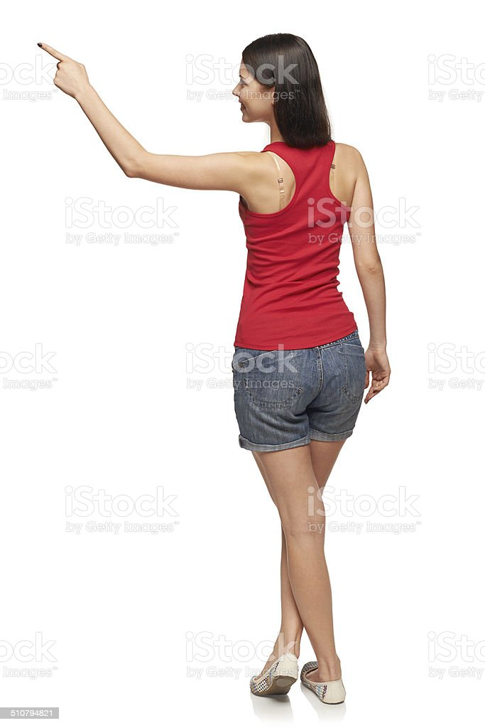 Female in full length pointing at blank copy space stock photo