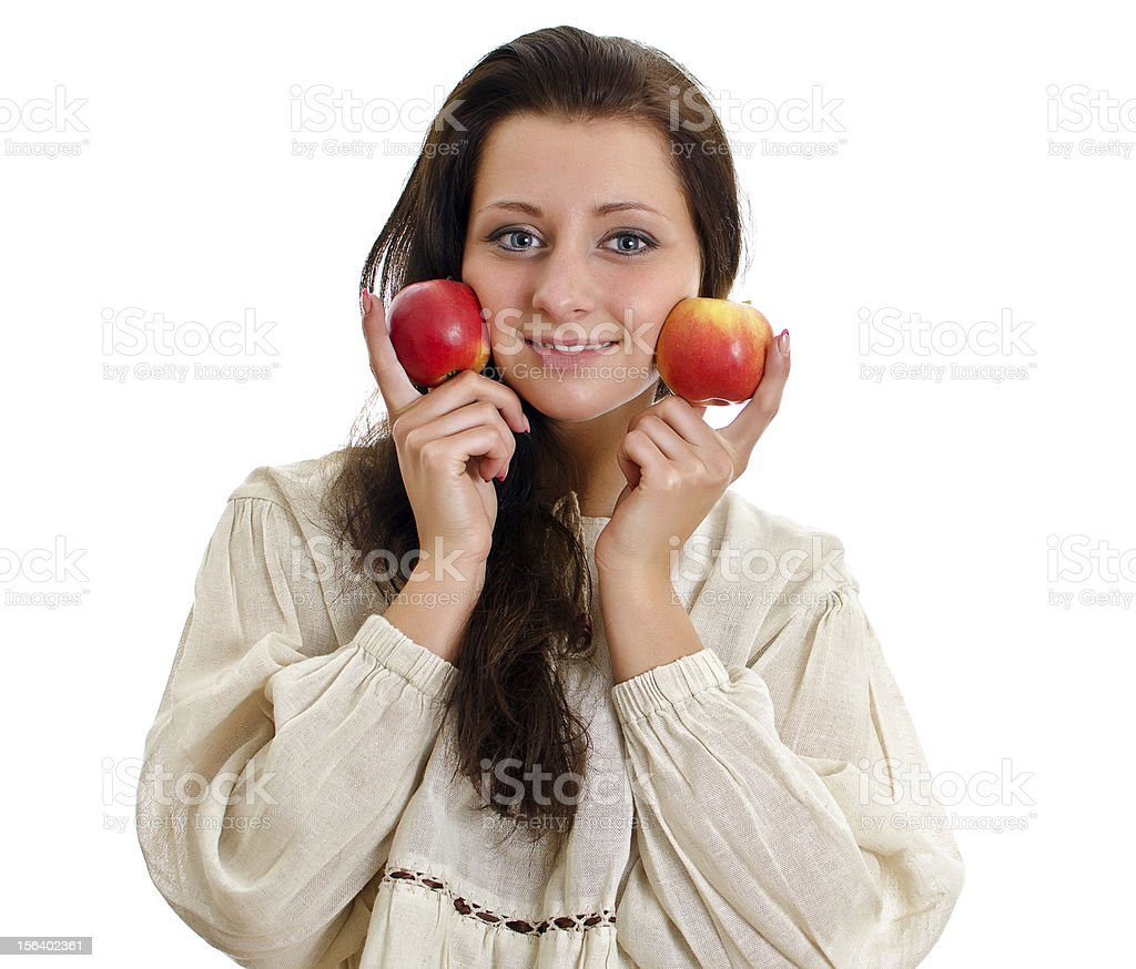 Female in national traditional costume with two apples. royalty-free stock photo