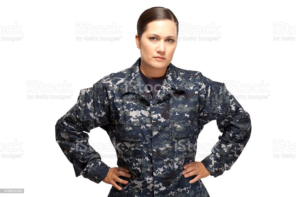 Female in navy uniform with hands on hips stock photo