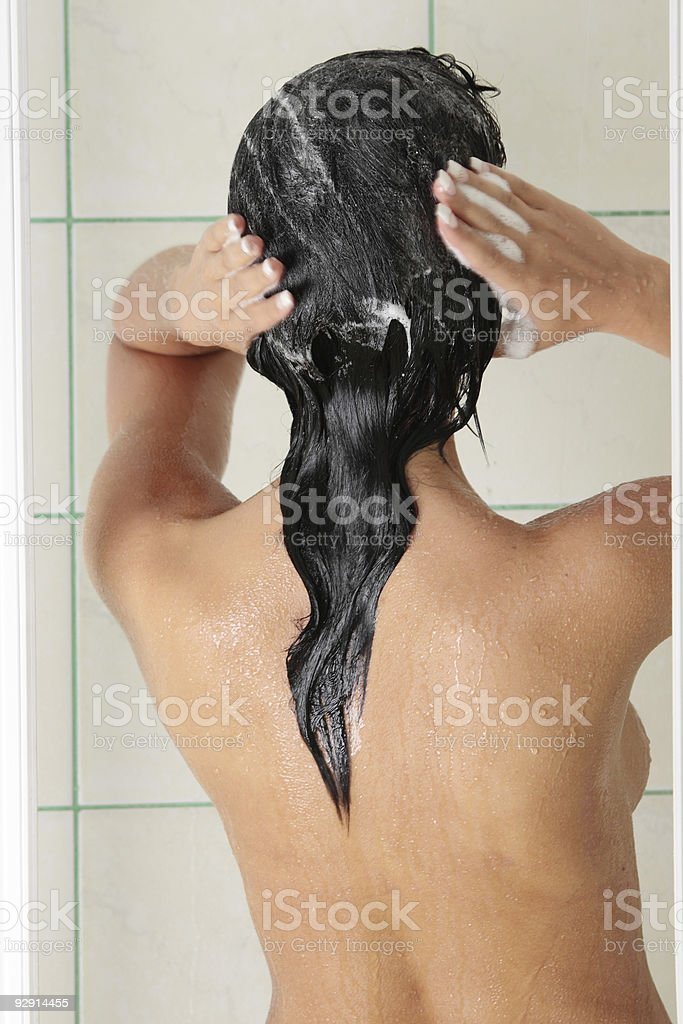 Female in shower royalty-free stock photo