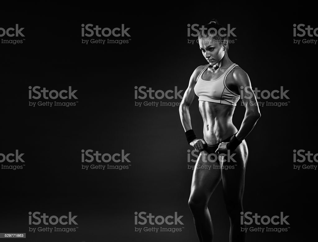 female in sports clothing relaxing after workout stock photo
