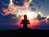 3D female in yoga pose against a sunset sky