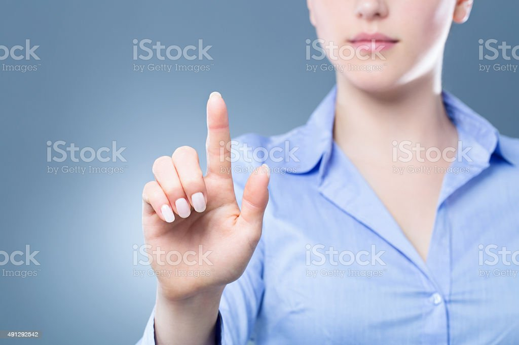 Female index finger pressing a virtual button stock photo