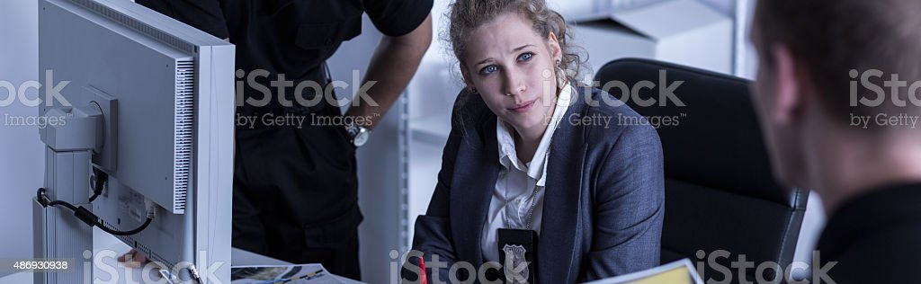 Female inspector and policemen stock photo