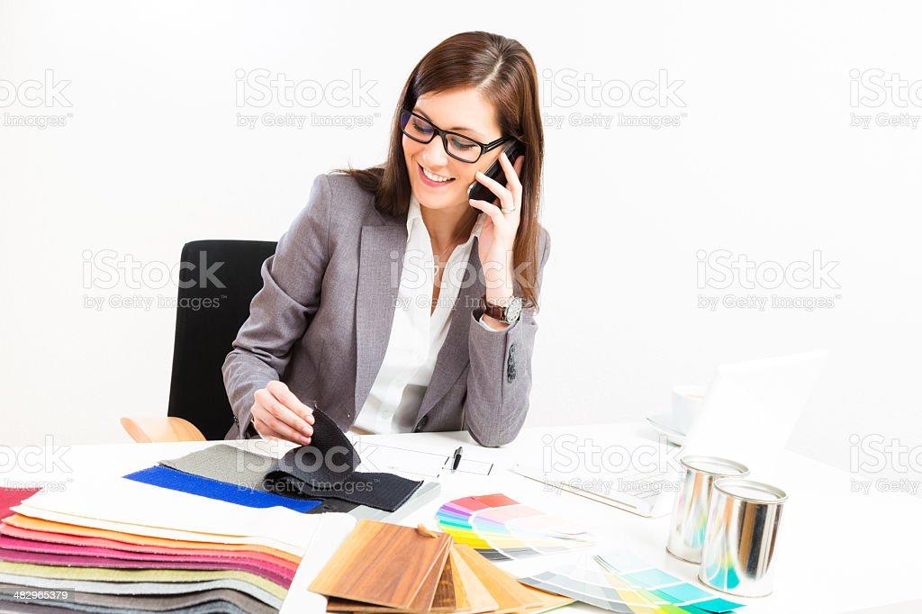female interior designer at her desk royalty-free stock photo