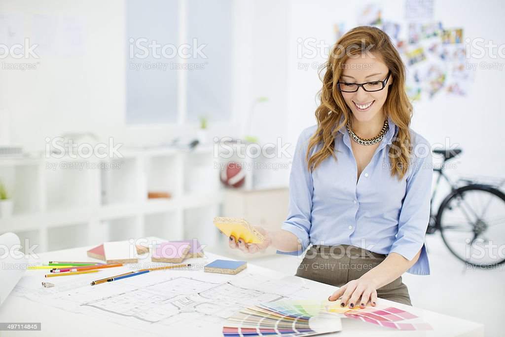Female Interior Designer At Work Stock Photo