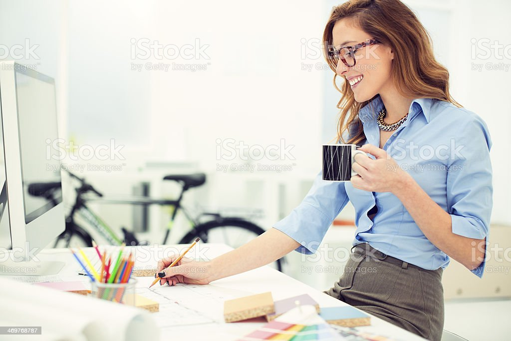 Female Interior Designer Sketching At Work. stock photo