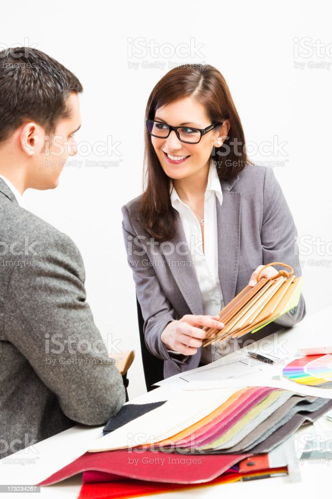 female interior designer with client royalty-free stock photo