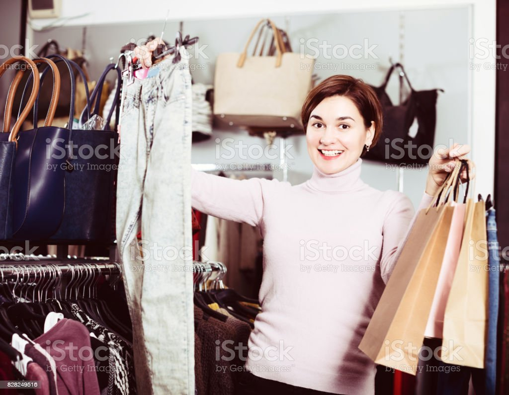 Female is choosing new jeans stock photo