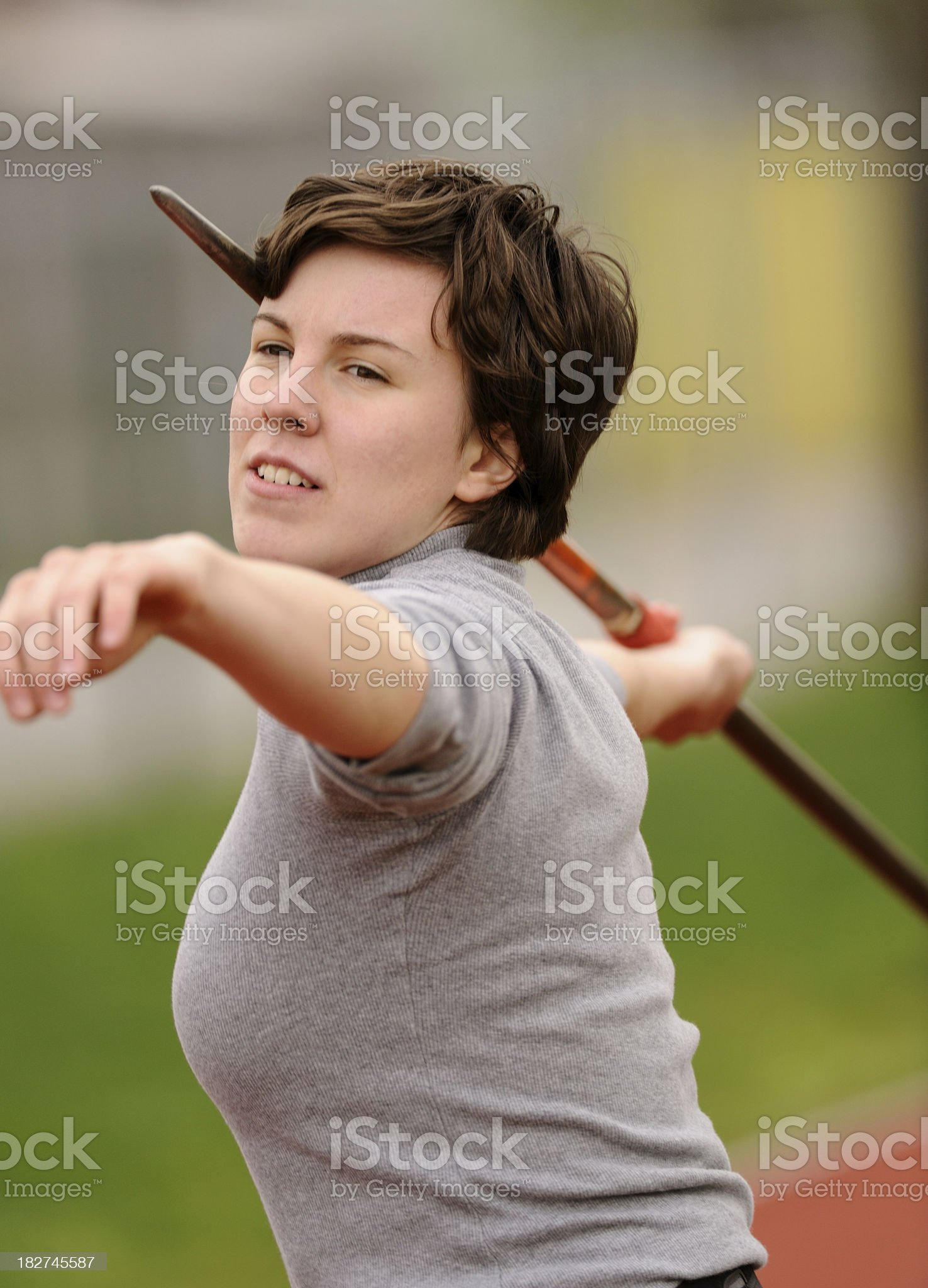 Female javelin thrower in the action royalty-free stock photo