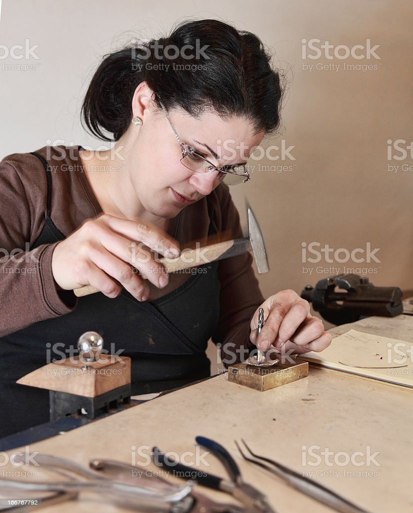 Female Jeweler Working stock photo
