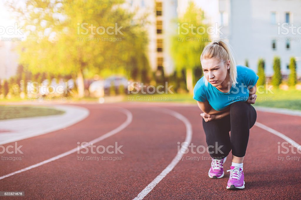 female jogger in a pain stock photo
