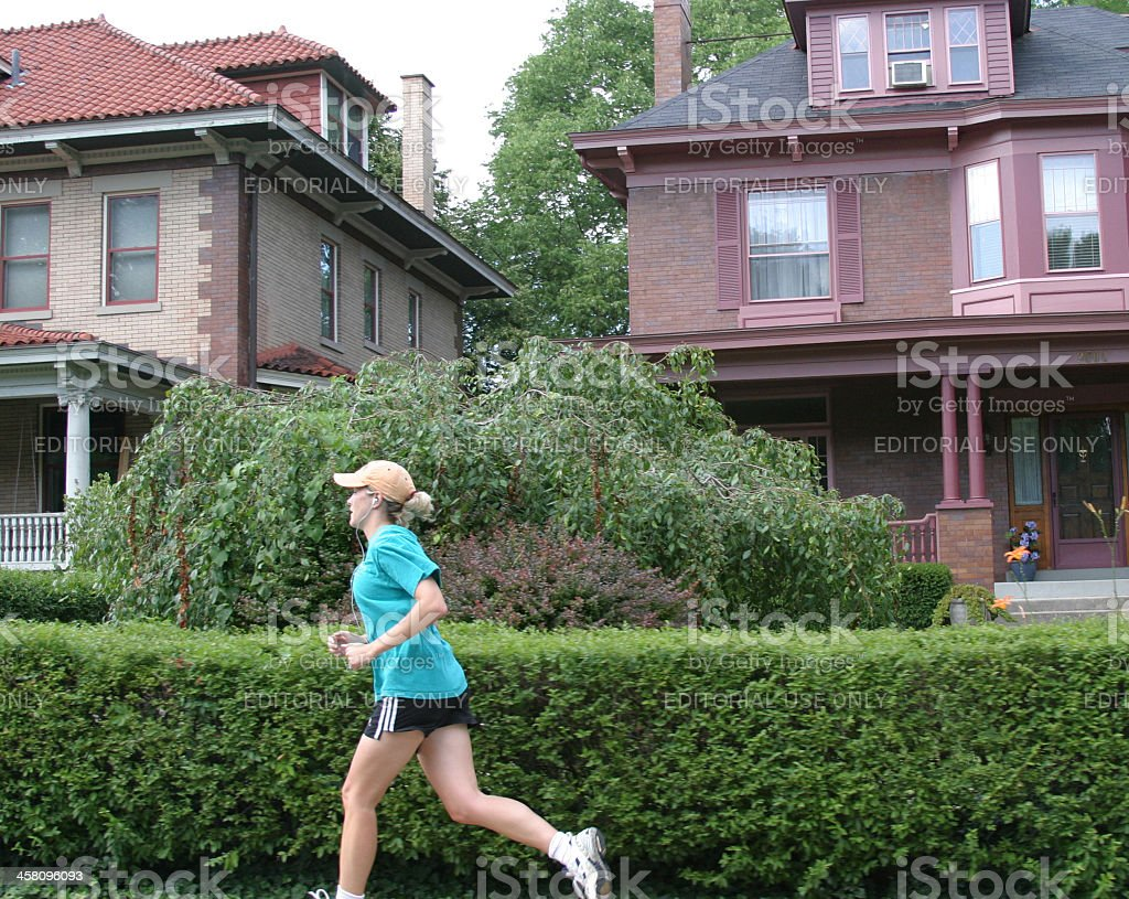 Female Jogger in Suburb stock photo