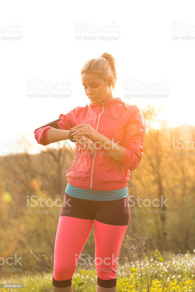 Female jogger pulse trace on smart watch stock photo