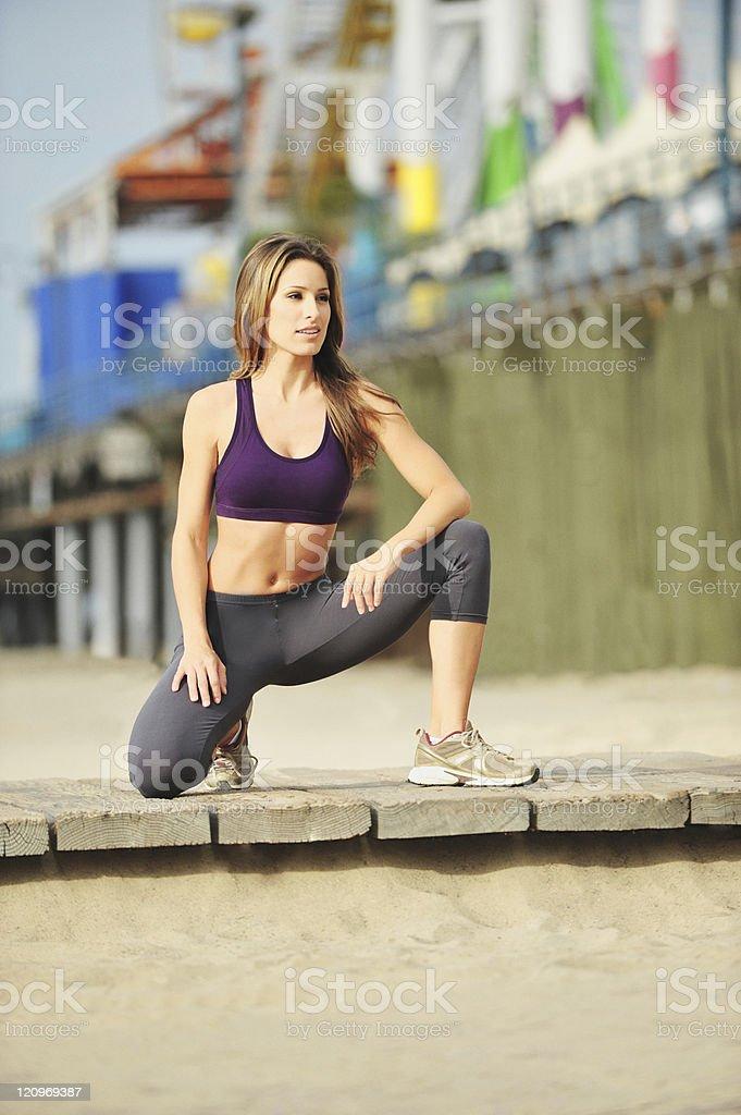 Female Jogger Resting on Boardwalk Santa Monica Beach California royalty-free stock photo
