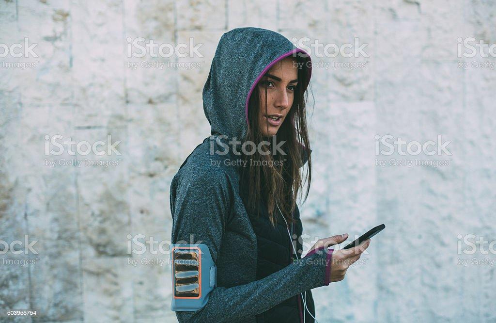 Female Jogger Using Phone stock photo