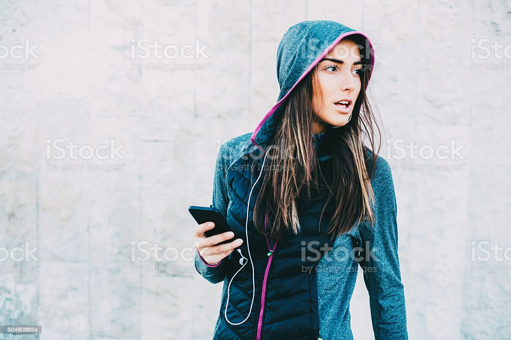 Female Jogger Using Phone stock photo