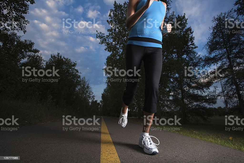 Female jogging early morning royalty-free stock photo
