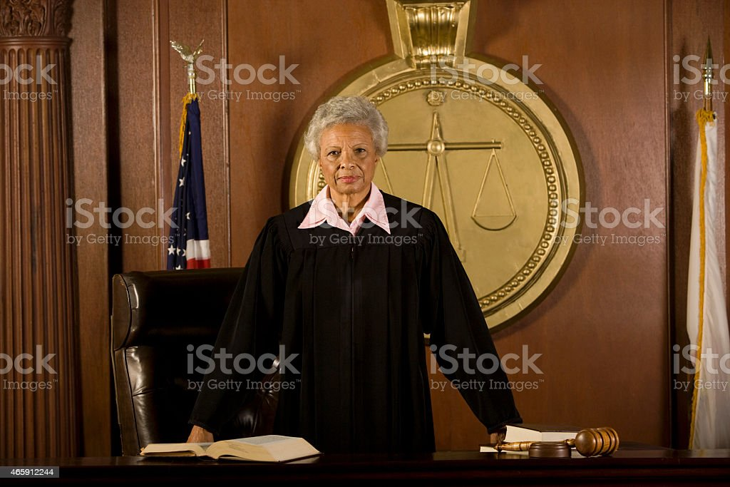 Female Judge Standing In Court Room stock photo
