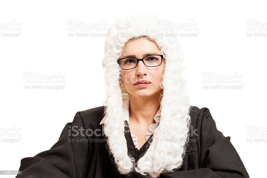 Female judge wearing a wig and Back mantle with eyeglasses stock photo
