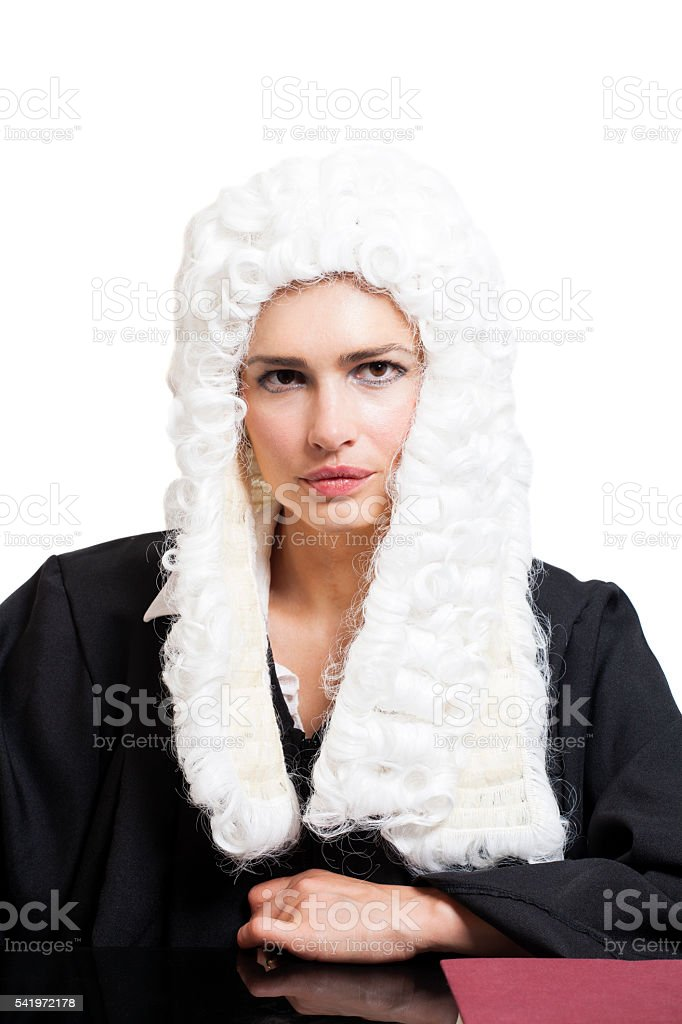 Female judge wearing a wig and black mantle stock photo