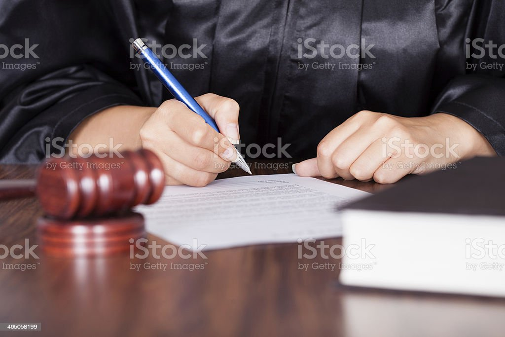 Female Judge Writing On Paper stock photo