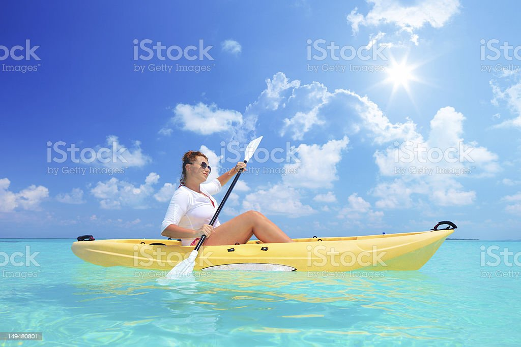 Female kayaking on a sunny day royalty-free stock photo