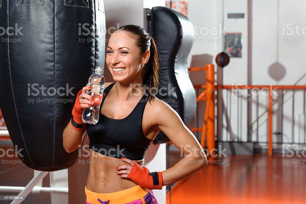 Female kickboxer drinks water stock photo