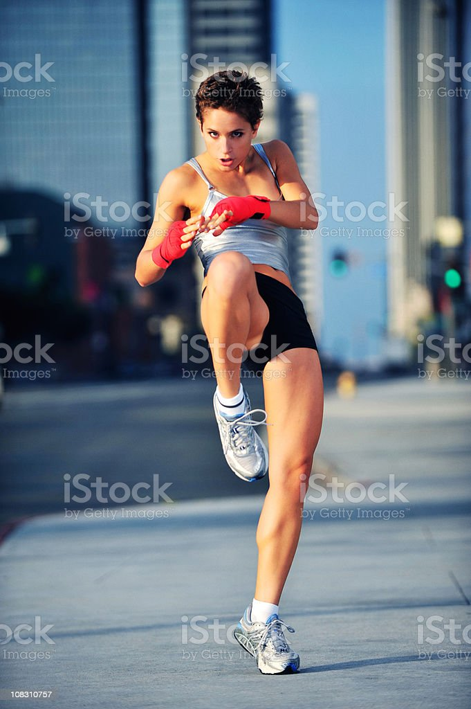 Female Kickboxer in Business District royalty-free stock photo