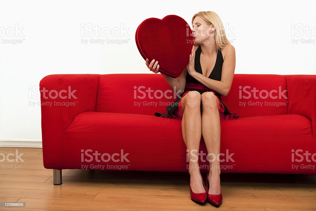 Female kissing a big heart shape royalty-free stock photo