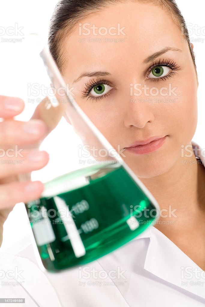 Female lab worker holding flask royalty-free stock photo