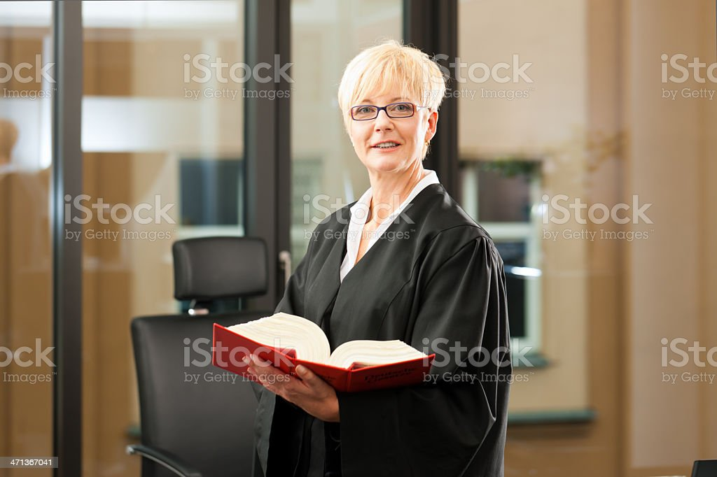 Female lawyer with German civil code stock photo