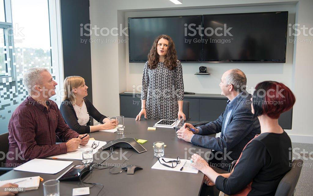 Female leader in modern office stock photo
