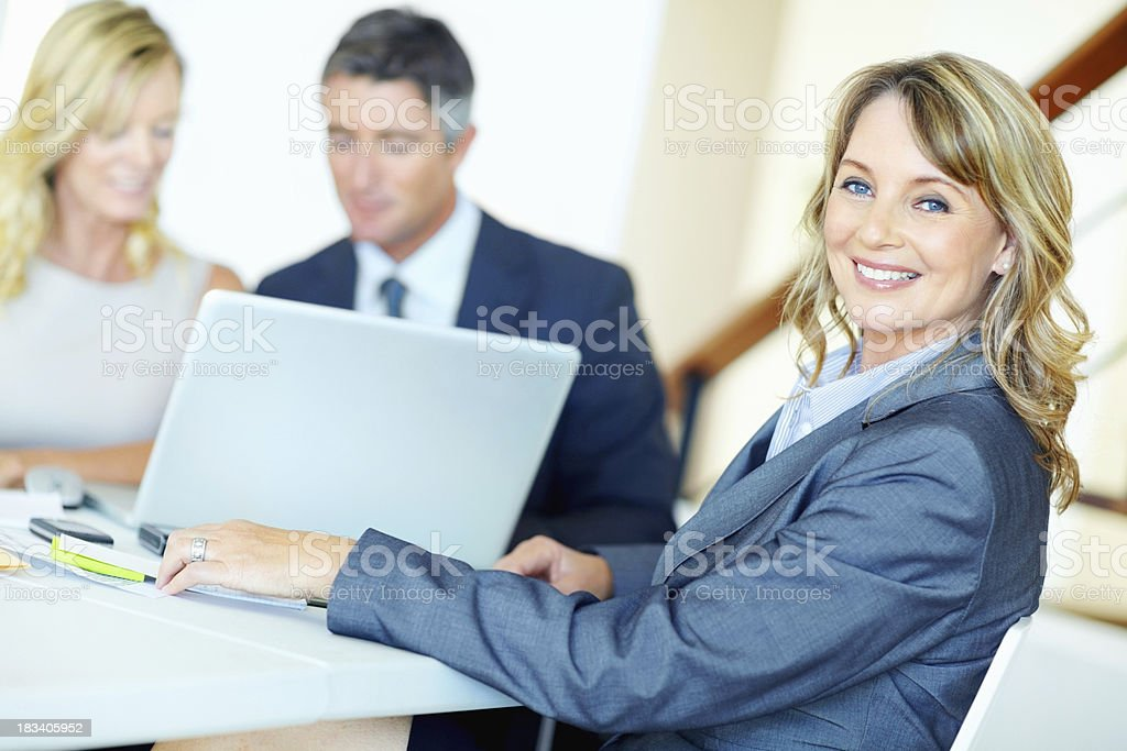 Female leader with team at meeting royalty-free stock photo