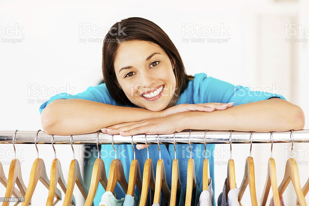 Female Leaning On Clothes Rail royalty-free stock photo